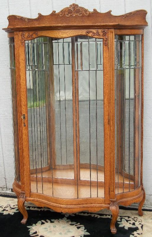 Oak Serpentine China Cabinet With Leaded Curved Glass Door And Sides